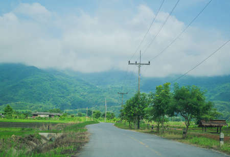 Road leading to mountains in Chiang Rai