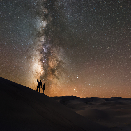 Silhouette of a couple star gazing