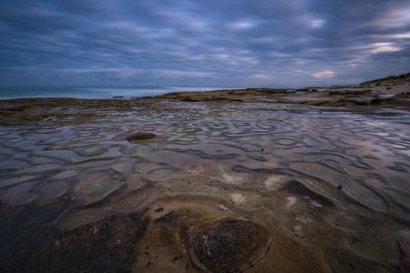 Unique rock formations along a beach in La Jolla California