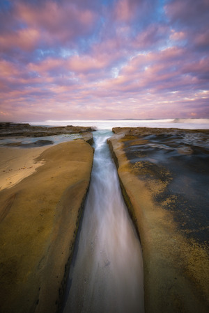 Incoming tide in a channel along the San Diego coastline