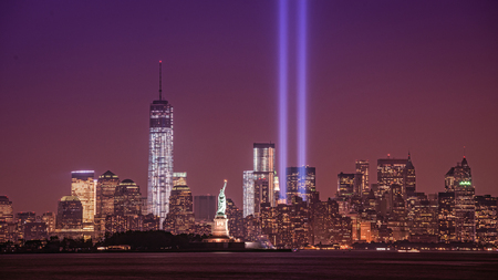 Tribute in Light with the Statue Of Liberty and Freedom Tower
