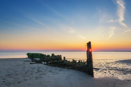 Shipwreck sunset along the bay Stock Photo
