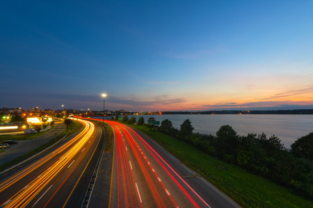Long exposure of car lights passing on a highway at dusk Stock Photo