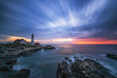 Long exposure cloud movement over Portland Head Lighthouse in Maine 免版税图像