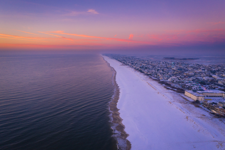 Aerial view of a coastline at sunrise
