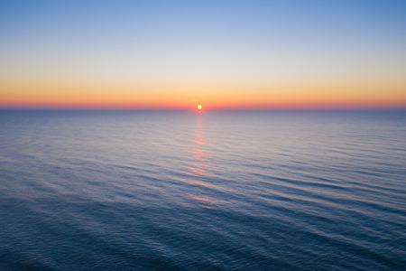 Aerial sunrise over the ocean Stock Photo