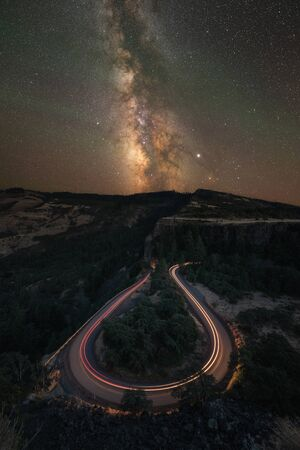 Long exposure of cars driving on horseshoe bend road at Rowena Crest in Oregon