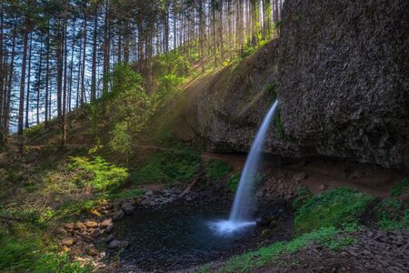 Sunshine over Upper Horsetail falls along the Columbia River Gorge, Oregon