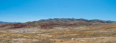 Colorful striations of different time periods in the sediment at Painted Hills in Oregon.