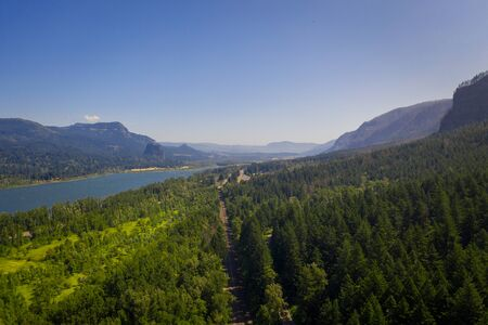 Beautiful aerial view of the Columbia River Gorge above train tracks