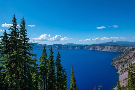 Daytime photos of Crater Lake in the summer months of Oregon