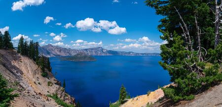 Beautiful view near a cliffs edge of Crater Lake and Wizard Island