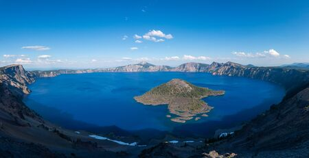 Wide angle view of Wizard Island and Crater Lake National Park in Oregon.