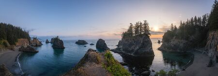 Beautiful sunset panorama of Secret Beach along the Pacific Northwest in Oregon.
