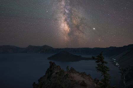 Beautiful night sky over Crater Lake as seen from Merriam Point in Oregon