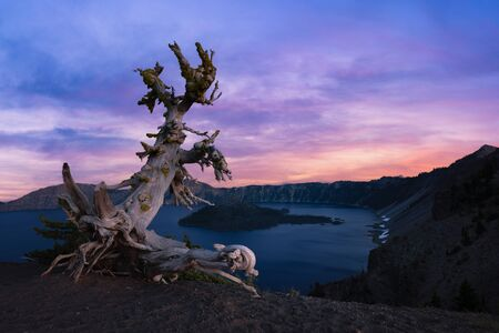 Beautiful sunset colors over Crater Lake and Wizard Island.