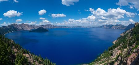 Panorama of an inactive volcano Wizard Island and a caldera known as Crater lake.