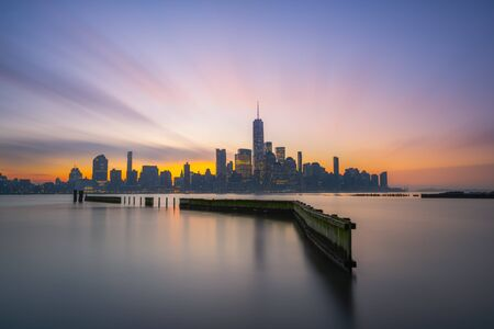 Long exposure sunrise from Jersey City of Lower Manhattan