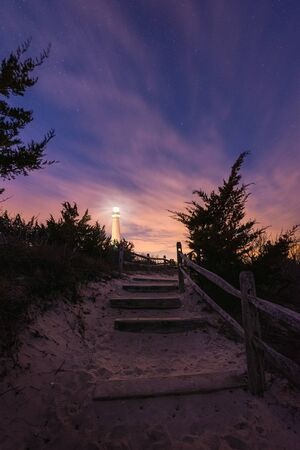 Sandy pathway leading towards Barnegat Lighthouse in New Jersey