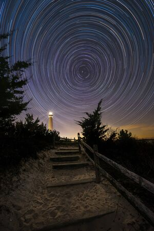 Pathway leading towards Barnegat Lighthouse and Star Trails