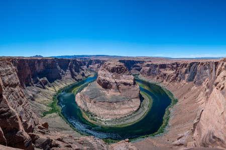 Clear blue sky over horseshoe bend in Arizona Фото со стока