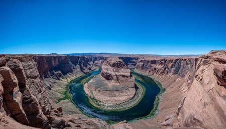 Clear blue sky over horseshoe bend panorama in Arizona