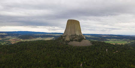 Aerial over Devils Tower and the wilderness in Wyoming