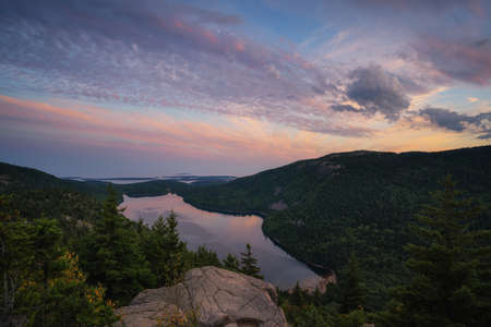 Colorful clouds over Jordan Pond overlook from North Bubble in Acadia National Park Maine