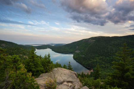 Clouds over a ledge overlooking Jordan Pond in Acadia National Park, Maine Stock fotó