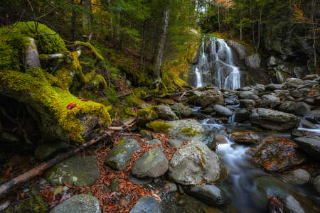Fall foliage surrounding Moss Glen Falls in Granville Vermont