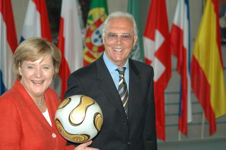 franz: JULY 6, 2006 - BERLIN: Chancellor Angela Merkel with German soccer legend Franz Beckenbauer at a reception in the Chanclery in Berlin.