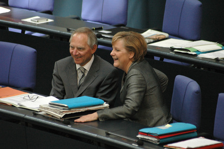 wolfgang: JUNE 29, 2006 - BERLIN: Wolfgang Schauble, Chancellor Angela Merkel  during a parliamentary session in the German parliament, the Bundestag in the Reichstags building in Berlin.