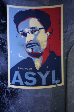 Sticker with the portrait of Edward Snoden and the slogan asylum, June 5, 2014 in Berlin. Editorial