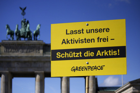 greenpeace: September 28, 2013 - BERLIN:  Let our activists free  (Release Our Activists  !) - Greenpeace protest against Russia by in front of the Brandenburg Gate in Berlin. Editorial