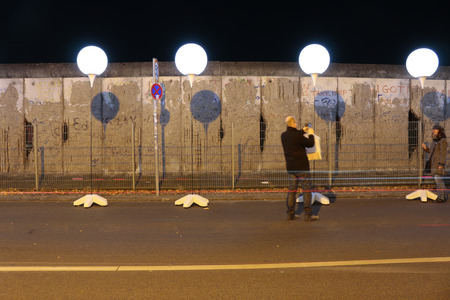 """25th: drawn up balloons for the light installation  """"light limit """" before the 25th anniversary of the Berlin Wall - Reststueck the Berlin Wall at the memorial site  """"Topography of Terror """", November 8, 2014 in Berlin-Mitte."""