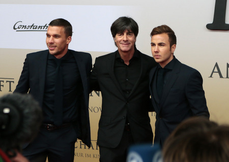 mario: Lukas Podolski, Joachim Loew, Mario Goetze - premiere of the film by the winning the Football World Cup 2014  The team  Sony Center, November 10, 2014 in Berlin. Editorial