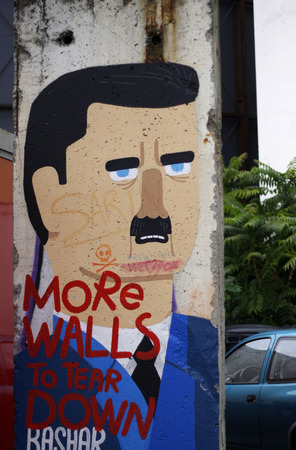 A piece of the Berlin Wall with the Syrian dictator Bashar Hafez al-Assad, Berlin-Mitte.