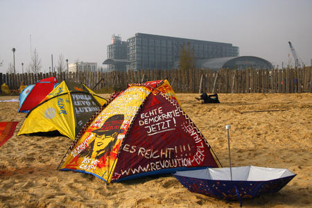 "occupy movement: Impressions: one for Federal Press beach belonging Brachgelaende has been occupied by the movement  ""Occupy "". The tolerated by the tenant squatter would like a makeshift tent camp against the omnipotence of the financial industry in our moder Editorial"