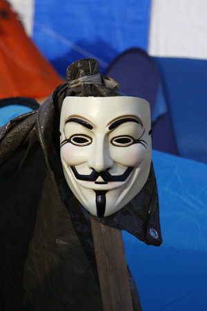 """Guy Fawkes - Mask: Impressions: one for Federal Press beach belonging Brachgelaende has been occupied by the movement  """"Occupy """". The tolerated by the tenant squatter would like a makeshift tent camp against the omnipotence of the financial in"""