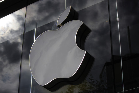 apple: Brand name: Apple icon on the wall