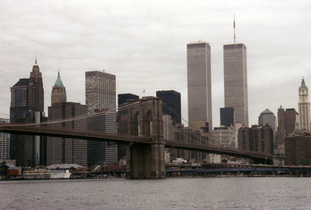 towers: JULY 1995 - New York: The skyline of Manhattan with the Twin Towers of the World Trade Center and the Brooklyn Bridge, Manhattan, New York. Editorial