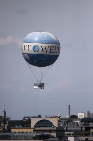 daily newspaper: Aerial view: Hot-air balloon with advertisements for the daily newspaper Die Welt, Berlin-Kreuzberg.