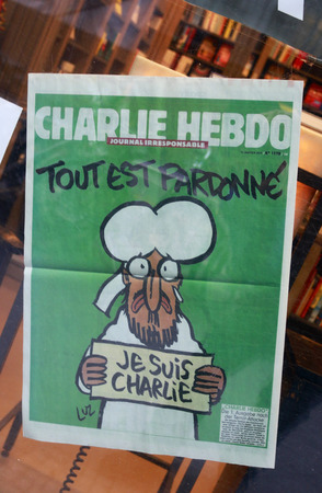 satirical: the cover cartoon of the Prophet Mohammed the issue of the satirical magazine Charlie Hebdo, a week after the terrorist Mass Acker by fanatical Muslims on its editorial, 14. January 2015 Berlin.