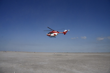 rescue helicopter: Rescue helicopter on the beach of St. Peter-Ording, Schleswig-Holstein.
