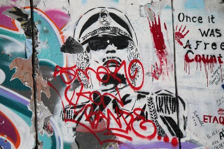 graffity: Gaddafi - Graffity, East Side Gallery, Berlin. Editorial