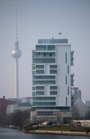 spree: Television Tower, Spree, skyscraper Living Levels at the East Side Gallery, Berlin-Friedrichshain. Editorial