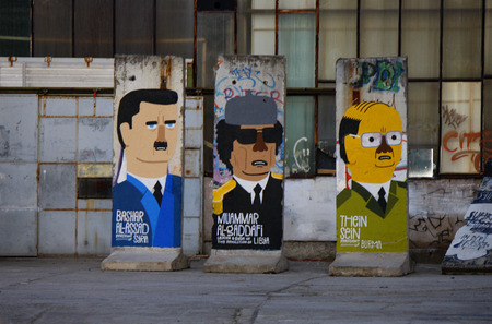 deposed: Bashar Hafez al-Assad Syria, Muammar al-Gaddafi Libya, Thein Sein Myanmar Laos - Mauerstuecke, are painted on the current or most recently deposed or deceased dictators, backyard, Berlin-Mitte.