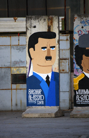 Bashar Hafez al-Assad Syria - Mauerstuecke, are painted on the current or most recently deposed or deceased dictators, backyard, Berlin-Mitte. Editorial