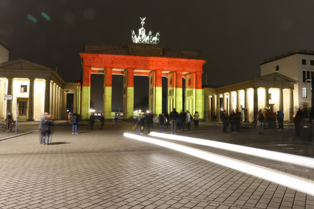 quadriga: impressions: The Brandenburg Gate is illuminated this time in the German national colors: Illumination of the Berlin landmark after the Islamic terrorist attack on the chrismas holiday market at Breitscheidplatz 20 December 2016 Berlin
