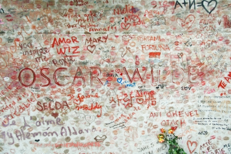 Oscar Wilde tombstone is covered in lips and poems and drawings playing tribute to him,